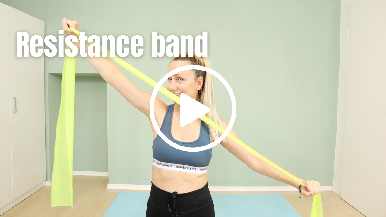 Pilates Instructor stretching resistance band