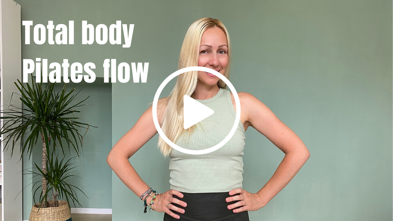 Pilates instructor standing with hands on hips
